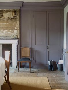 Dining room in Romilly Saumarez's East London house has reinstated fire surround & new joinery, but chimney breast paneling was left as found.