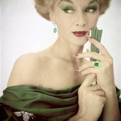 Lisa Fonssagrives (Mrs. Irving Penn) wearing jewelry by Van Cleef & Arpels.  Photo by Clifford Coffin.  Vogue, October 15, 1951.