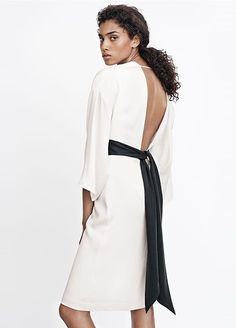 Proof That Sustainable Fashion Found At The Mall Can Be Beautiful #refinery29  http://www.refinery29.com/2015/03/83915/hm-conscious-collection-olivia-wilde#slide-3  Baby got an open back...and a pretty sash, too.