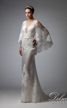 Sheath dress in and embroidered French chantilly lace. Plunging neckline and wide sleeves that form a cape effect.