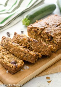 Oatmeal Coconut Chocolate Chip Zucchini Bread is a super moist whole grain quick bread studded with flaked coconut and dark chocolate chips!