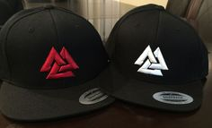 This high quality Snapback hat features an symbolic Viking symbol: the Valknut which is placed on the front of the hat and 'HAIL ODIN' on the back. Available with red or white snitching on a premium q