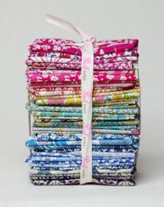 Love the colors in this stack of fabric. Too rich for my blood, though, but I would happily take it as a gift. ;-)