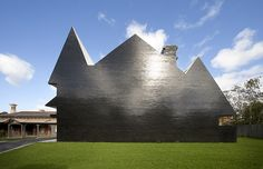 Loving the use of the black glazed brick that turns the side of this school building into a shiny silhouette. The view of the building from this perspective also gives a really interesting play of 2D representation made large and actual 3D space. PEGS Junior School by McBride Charles Ryan.