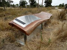Oakwood Park, reclaimed red river gum from site, laser etched stainless steel plaque, galvanised support frame