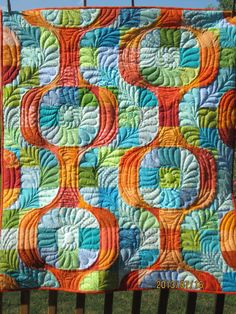 mod pop - whoa! This is a gorgeous take on the pattern both in color and quilting