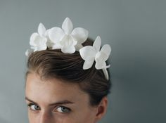 A clean, utterly modern, and super-stylish take on the flower crown, our orchid headpiece is an absolute showstopper. 3D printed from smooth matte nylon, it's a refreshingly organic take on a high-tech process. Three orchids and a spray of buds arch elegantly over the head- this can be styled a variety of ways, but we love it as a Frida-Kahlo-esque headband. Featured in the Shapeways Headware collection.