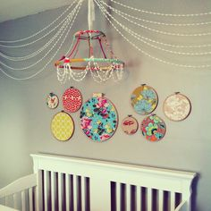 DIY chandelier (from old lamp shade, covered in fabric scraps) with Pom-Pom garland and hoops! www.angiedweldon.com