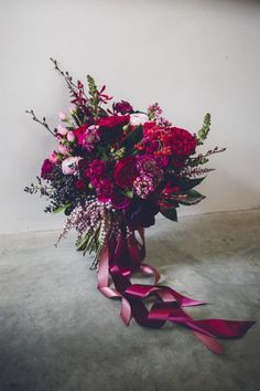magenta bouquet with ribbons