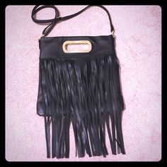 Black Fringe boho bag! NWOT*** Black with gold accents. New and never used. Adjustable and detachable straps- can be worn as Crossbody, shoulder, or clutch! Super cute!! Bags