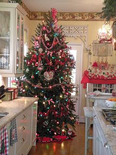 Christmas Kitchen: Love this, but Doug would kill me. We pretty much already put a Christmas tree in every room. Christmas Kitchen, Noel Christmas, Merry Little Christmas, Country Christmas, Winter Christmas, All Things Christmas, Vintage Christmas, Christmas Crafts, Christmas Decorations