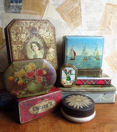 a selection of vintage storage tins - biscuits, sweets, cigarettes, cigars