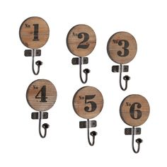 Whether you hang these hooks by the front door, in the bathroom, or beside the stove, this set of numbered hooks look great on any wall. Made by hand from gorgeous fir wood and durable iron, they hold onto your lightweight items in rustic-industrial style.
