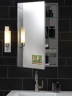 A TV in the bathroom mirror?!! LOVE! Hot Trends in Bathroom Fixtures : Home Improvement : DIY Network