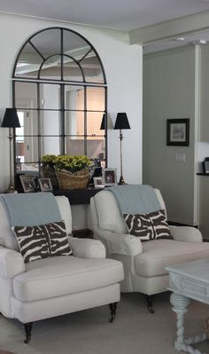 Large mirrors are a great way to create a focal point on a wall. Here, the Grand Palais wall mirror looks fantastic in a living room designed by Sherry of Design Indulgence blog.