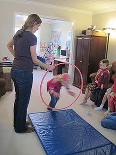have kids jump through hoola hoop .  but need mat for safety