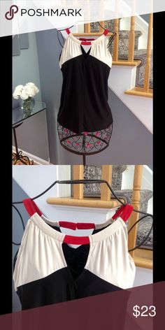 NWOT The Limited Top NWOT The Limited halter style top in knit.  It has a peep hole in the front and is black, ivory and red. Never worn!  So cute! The Limited Tops Blouses