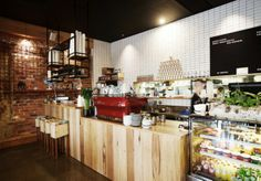 Fumanchu, Melbourne. Stunning red La Marzocco, gorgeous rustic timber & industrial exposed brick.