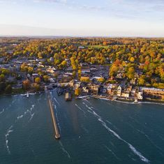 Aerial of Small Village on Lakeshore in Autumn Small towns to visit Best Places To Travel, Places To See, Weekend Trips, Weekend Getaways, Rafting, Small Towns, National Parks, Scenery, Vacation Ideas