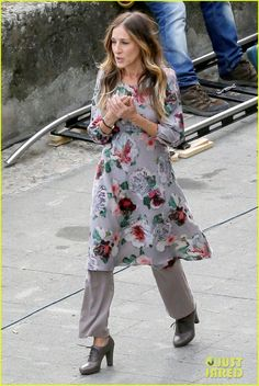 Sarah Jessica Parker rocks a dress over pants while filming All Roads Lead to Rome.