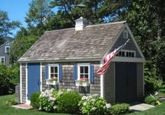 Sweet Patriotic Cape Cod Shed