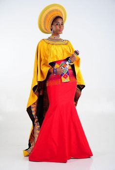Shifting Sands African Couture is a well-known name in the traditional wedding dresses scene in South Africa. See 16 of their modern traditional gowns inspired by African cultures, beads, colours and textures South African Dresses, Wedding Dresses South Africa, African Bridal Dress, African Wedding Attire, African Attire, African Fashion Dresses, African Wear, Zulu Traditional Wedding Dresses, Zulu Traditional Attire