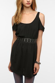 "Black ""cold shoulder"" short dress with embellished waist & rock n' roll accents by Silence & Noise from Urban Outfitters."