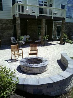 like the round fire pit with curved sitting wall next to it