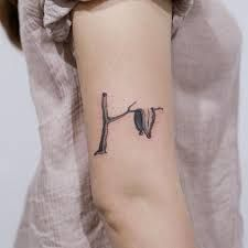 Salvador Dali Melting Clocks Tattoo