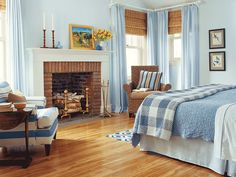 love the warmth of the wood with blue...great window treatment and chair upholstery