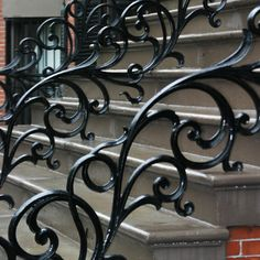 Wrought iron railings flank Clarendon Square's front steps