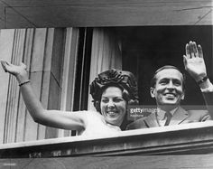 Princess Beatrix of the Netherlands and her fiancee Claus van Amsberg (1926 - 2002) waving from a balcony during a visit to Amsterdam, 6th July 1965.