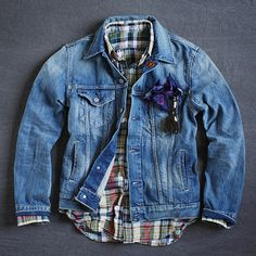 If there ever was a holy trinity in Menswear this would have to be it. Madras plaid, Denim Trucker Jacket and Functional Pocket Square. The Wayfarers just elevate it to an even higher level.