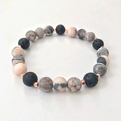 Excited to share the latest addition to my #etsy shop: Essential Oil Diffuser Bracelet, Lava Bead Aromatherapy Bracelet, Pink Gemstone Beaded Bracelet, Yoga Bracelet