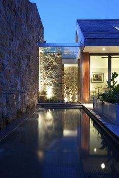 Water feature in the courtyard of a traditional Guernsey farmhouse with contemporary extension. Water, Reflection, Dusk, Light