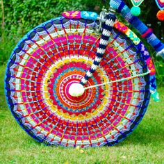 Reverse side of crochet wheel for yarn bomb bike by Emma Leith Guerilla Knitting, Tour Of Britain, Bicycle Decor, Crochet Mandala, Crochet Art, How To Make A Pom Pom, Yarn Bombing, Bike Art, Learn To Crochet