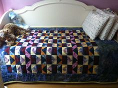 Flying Geese quilt I made for my daughter, the back has pieced hearts in same fabrics
