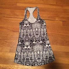 Lululemon tank Black and white pattern lululemon tank. Like new condition, just doesn't fit me. Tag removed but size 4 lululemon athletica Tops Tank Tops