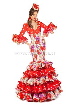 Si estás buscando un vestido de gitana al más puro estilo que dicta la tradición de la moda flamenca, el modelo Alcazaba es la opción adecuada. Confeccionado en excepcional tela de pasepan, en este traje de flamenca se combinan los estampados de motivos florales con los lunares blancos. El talle debajo del pecho y los volantes rojos en la manga al codo y la falda, están decorados con cintas de encaje de guipur en color blanco. El modelo Alcazaba es un traje de flamenca de estilo clásico que…