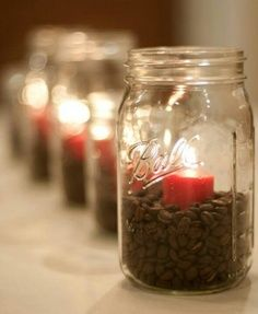 rehearsal dinner centerpiece, whole coffee beans, a cream candle and then tie burlap or jute string around mason jar! Love this!