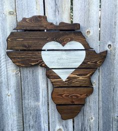 This jigsawed Africa is handmade out of upcycled pallets. The unique upcycled pallet boards are stained in espresso with the heart hand painted on in white and distressed. This piece is great for anyo Out Of Africa, West Africa, South Africa, African Wall Art, Yoga Studio Design, Maputo, African Safari, Africa Travel, Black Art