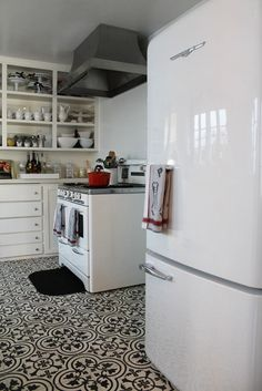 This fridge is cool because it's retro but also looks modern enough that when you went to sell your house people wouldn't think it was ugly or weird. Also I like how the stove hood is metal but not shiny.