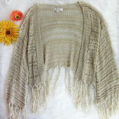 CLOSET WIDE SALE Wide sleeved fringe kimono Excellent condition! No flaws. Perfect finishing touch to your bohemian or festival outfit. Armpit to armpit approx 19 inches. Length approx 26 inches. Shorter in back when worn.  Bundle for best deals! Hundreds of items available for discounted bundles! You can get lots of items for a low price and one shipping fee!  Follow on IG: @the.junk.drawer umgee Sweaters Cardigans