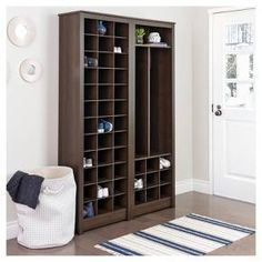 Simply and stylishly organize up to 36 pairs of shoes with the Space-Saving Shoe Storage Cabinet by Prepac. Fit one cabinet in a narrow entryway or combine multiple pieces from the Space-Saving collection in a large mudroom to create a custom closet look at the fraction of the cost. This shoe organizer has 36 spacious cubbies that can be used to store shoes, hats, scarves, keys, mail and any other clutter that needs organizing.
