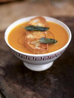 Superb squash soup with the best Parmesan croutons - olive oil, sage, red onions, celery, carrots, garlic, rosemary, red chilli, sea salt, black pepper, butternut squash or onion squash or musque de Provence, chicken or vegetable stock, extra virgin olive oil, ciabatta bread, Parmesan cheese