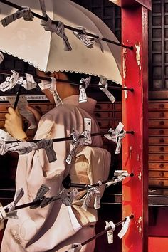 Omikuji, or rolled up fortunes are random fortunes written on strips of paper at Shinto shrines and Buddhist temples in Japan.  The omikuji predicts the person's chances of his or her hopes coming true, of finding a good match, or generally matters of health, fortune, life, etc.