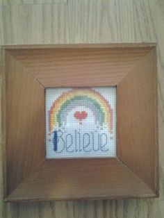 Rainbow Believe 5X5 frame with a 3X3 opening.