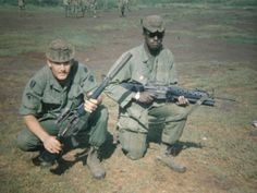Two soldiers of the 35th Infantry, both with M16s, one is suppressed and the other has a grenade launcher. ~ Vietnam War