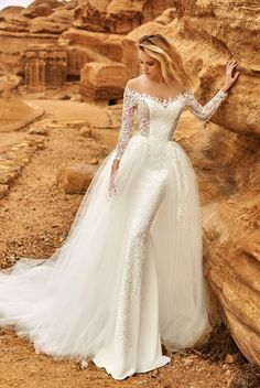 Luxurious and mysterious Oksana Mukha 2018 wedding dress for the most prestigious wedding. Created for charming brides who are accustomed to decorate the world.Nude Fatin with a gentle waterfall falls to the bottom, extending the silhouette. Thanks to the perfect texture, which only decorates the sun's rays, framing the silhouette, makes the image charming and fabulous. The corset will fulfill the dreams of even the most demanding fashionistas – the cappuccino net-tulle creates the effect of…
