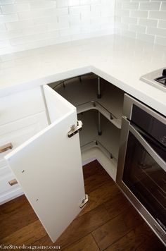 I didn't want to waste one inch of the space so I used corner cabinets on each side of the oven